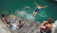 Children diving in, Castro Urdiales, Cantabria, Spain