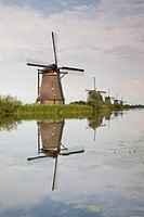 Windmills reflecting in surrounding polder waters, Kinderdijk, Nieuw_Lekkerland, Netherlands