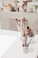 Paintbrushes in jars in art studio