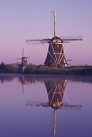 windmill, canal, Kinderdijk, Holland, Netherlands, Zuid_Holland, Europe, Mills of Kinderdijk, Working windmills along a canal in the early morning in ...