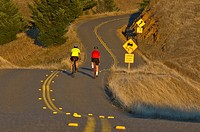 Bicycle riders on country road , Northern California,USA