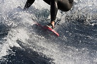 A closeup of a woman wakeboarding on Lake Tahoe in California