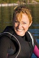 A smiling woman in a wetsuit on Lake Tahoe in California