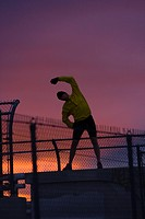 A man stretching before running at sunset in Reno in Nevada