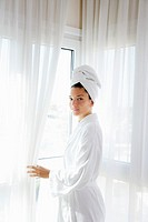 Bathrobe happy woman sunny hotel window white curtains (thumbnail)