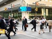 Canada,Ontario,Toronto,pedestrians crossing street in the financial district of the city