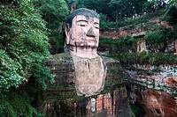 Giant statue of Buddha carved on rock, Leshan Giant Buddha, Leshan, Sichuan Province, China