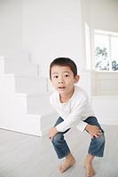 Boy squatting