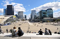 People sitting on the stairs of the Grande Arche (1989 by Danish architect Otto von Spreckelsen and Danish engineer Erik Reitzel), La Defense business...