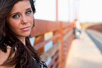Portrait of teenage girl standing on bridge