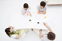 Four people meeting at table