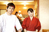 Portrait of waiter and waitress at Japanese restaurant