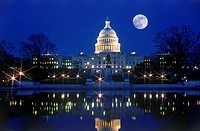 Capitol Building in Washington D C under full moon at night