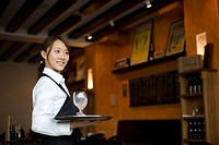 Waitress holding tray with glasses of water