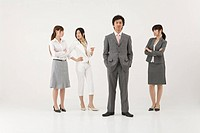 Three businesswomen looking at businessman