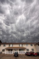 Mammatus clouds roll overhead an apartment complex in Kearney, Nebraska, June 7, 2010