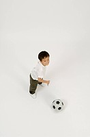 Elementary age boy playing with soccer ball
