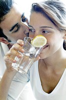 Couple drinking a glass of water