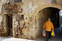 Europe, Greece, Western Crete, Chania, old town. Man walking under venetian house