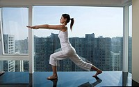 Asian woman doing Tai chi chuan