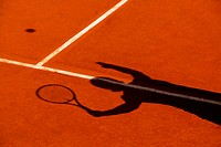 Shadow of tennis player in action