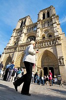 People in front of Notre-Dame Cathedral. Île de la Cité. Paris, France