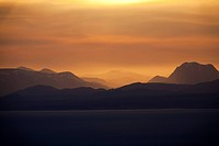Scotland, Isle of Skye, Trotternish. A view at sunrise from the Quiraing towards the distant hills on the mainland.