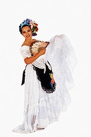 Portrait of a mid adult woman holding a folding fan
