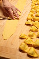 Hand of woman preparing tortellini