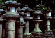 JAPAN, NARA, KAGUGA SHRINE STONE LANTERNS COVERED WITH MOSS SHINTO