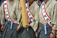Detail of a crowd of worshippers carrying a shrine into the Asakusa Kannon Temple in Tokyo,Japan