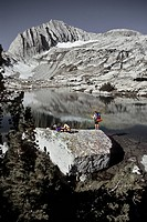 Backpackers fishing and relaxing at the Hoover wilderness and Mount Conness, California, USA