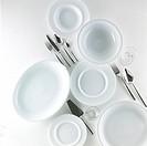 Assorted plates, glass adn cutleris