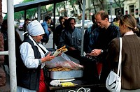 RUSSIA, VLADIVOSTOK, STREET SCENE WITH STREET VENDOR SELLING FOOD