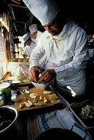 RUSSIA, TRANS_SIBERIA SPECIAL TRAIN, CHEFS PREPARING FOOD IN KITCHEN CAR