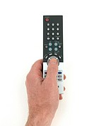 A remote control held in the hand isolated against a white background