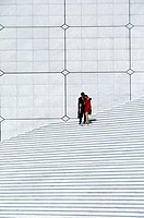 France, Paris. Couple on steps of La Defense