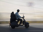 Two person on motorscooter