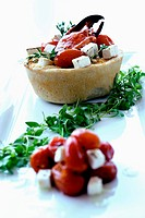 Lobster quiche with tomatoes and feta