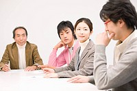 Four people discussing in meeting room