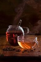 Cup of yellow fruit tea and pot of red fruit tea