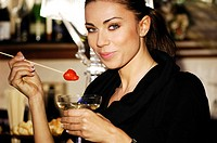 Woman having champagne with strawberry