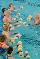 Senior citizens performing water aerobics in the pool at the YMCA.