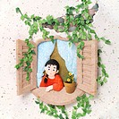 Scene of little girl looking out the window made out of rice paper