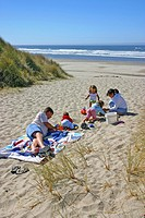 Family on dunes at South Beach State Park beach near Newport Oregon