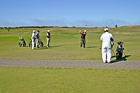 Golfers and caddies at Bandon Dunes Golf Resort Bandon Oregon