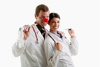 Male and female doctors with party toys