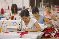 SHENZHEN, GUANGDONG PROVINCE, CHINA _ Women workers in a garment factory in city of Shenzhen, one of mainland China´s first Special Economic Zones, SE...