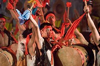 Sani ethnic minority drummers, wearing traditional Charwa or sheepskin vests, at stadium performance that culminates the annual June Torch Festival, S...