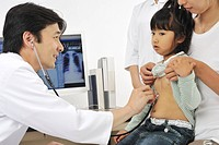 Male doctor examining girl